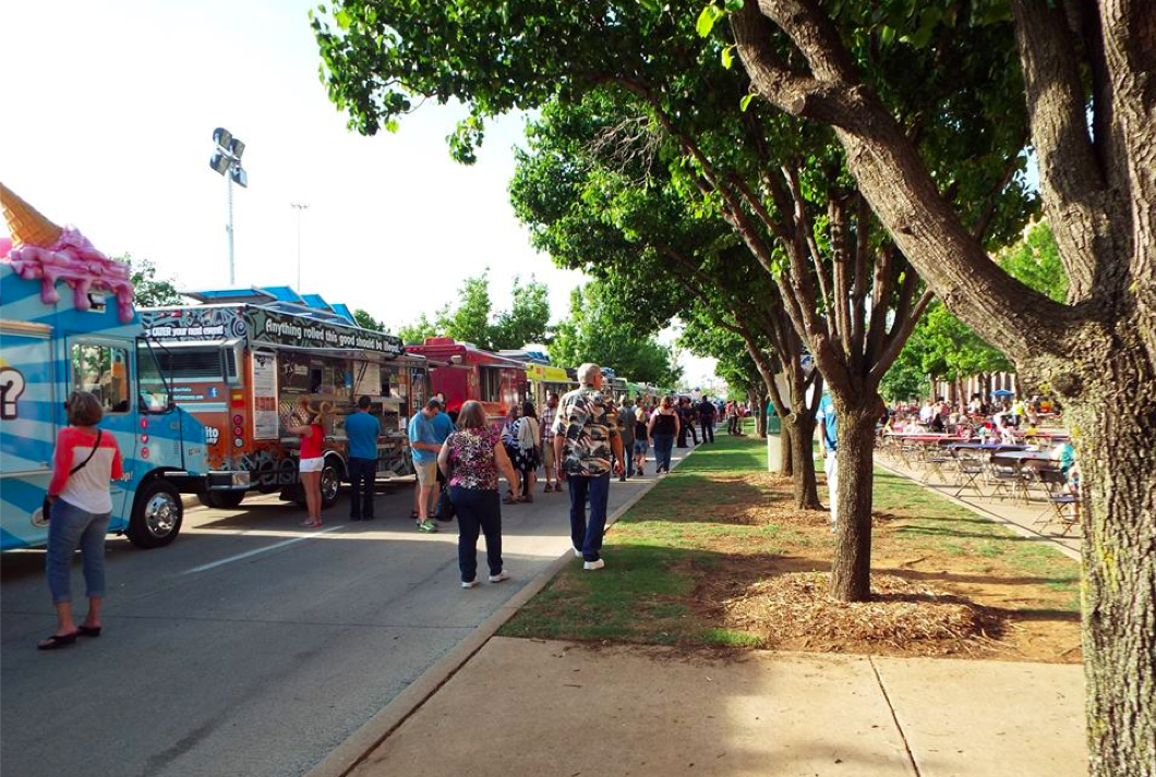 Fans explore the Texas Food Truckin' Fest in Arlington, TX.